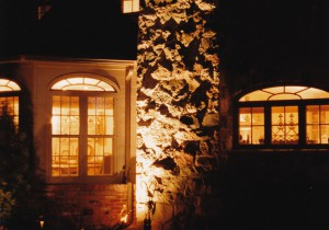 Natural stone chimney's texture is emphasized by a combination of lighting sources.